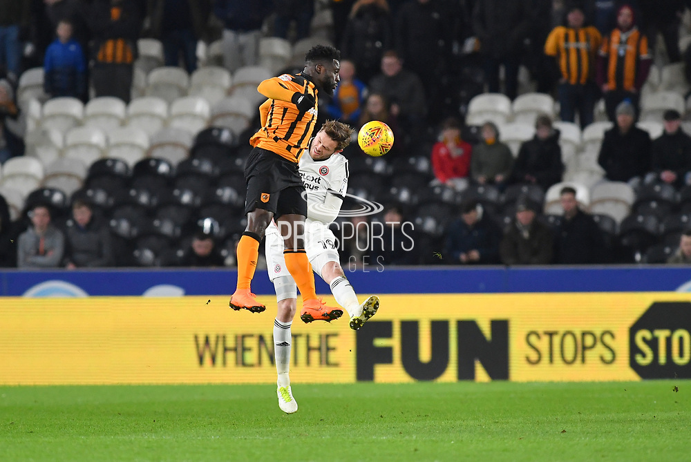 Sheffield United defender Richard Stearman (19) and Hull City forward Nouha Dicko (9) during the EFL Sky Bet Championship match between Hull City and Sheffield Utd at the KCOM Stadium, Kingston upon Hull, England on 23 February 2018. Picture by Ian Lyall.