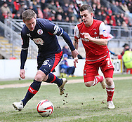 Picture by David Horn/Focus Images Ltd +44 7545 970036.23/02/2013.Dean Cox (right).of Leyton Orient is held off by Dannie Bulman (Captain)  of Crawley Town during the npower League 1 match at the Matchroom Stadium, London.