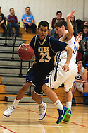 Essex's Eli Baez (23) drives to the hoop past Colchester's Justin Evans (11) during the boys basketball game between the Essex Hornets and the Colchester Lakers at Colchester High School on Tuesday night December 15, 2015 in Colchester. (BRIAN JENKINS/for the FREE PRESS)