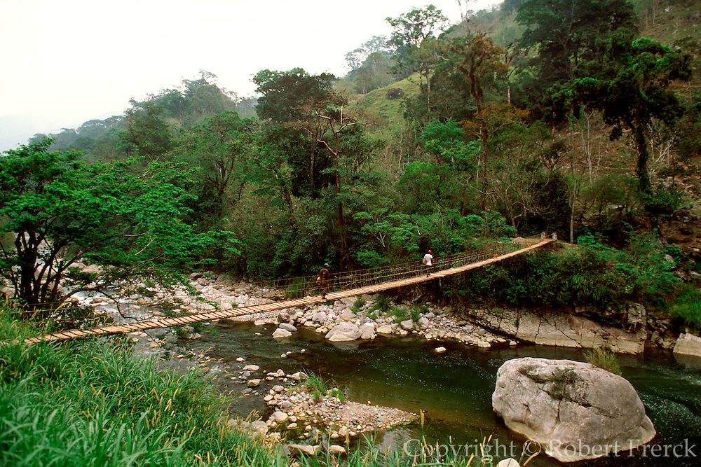 MEXICO, LANDSCAPES, CHIAPAS STATE Lush jungle mountain scenery on Tabasco/Chiapas border near village of Ixhuapan; suspension bridge