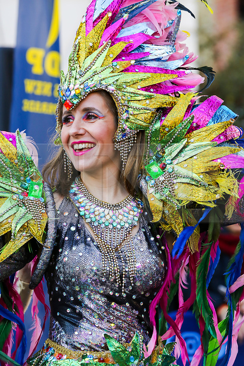 © Licensed to London News Pictures. 30/12/2019. London, UK. A performer from London School of Samba performs at the preview of the London New Year's Day Parade inCovent Garden Piazza.<br /> The London New Years Day Parade, in its 32nd year will take place on 1 January 2020 and will feature more than 10,000 performers from across the world. Photo credit: Dinendra Haria/LNP