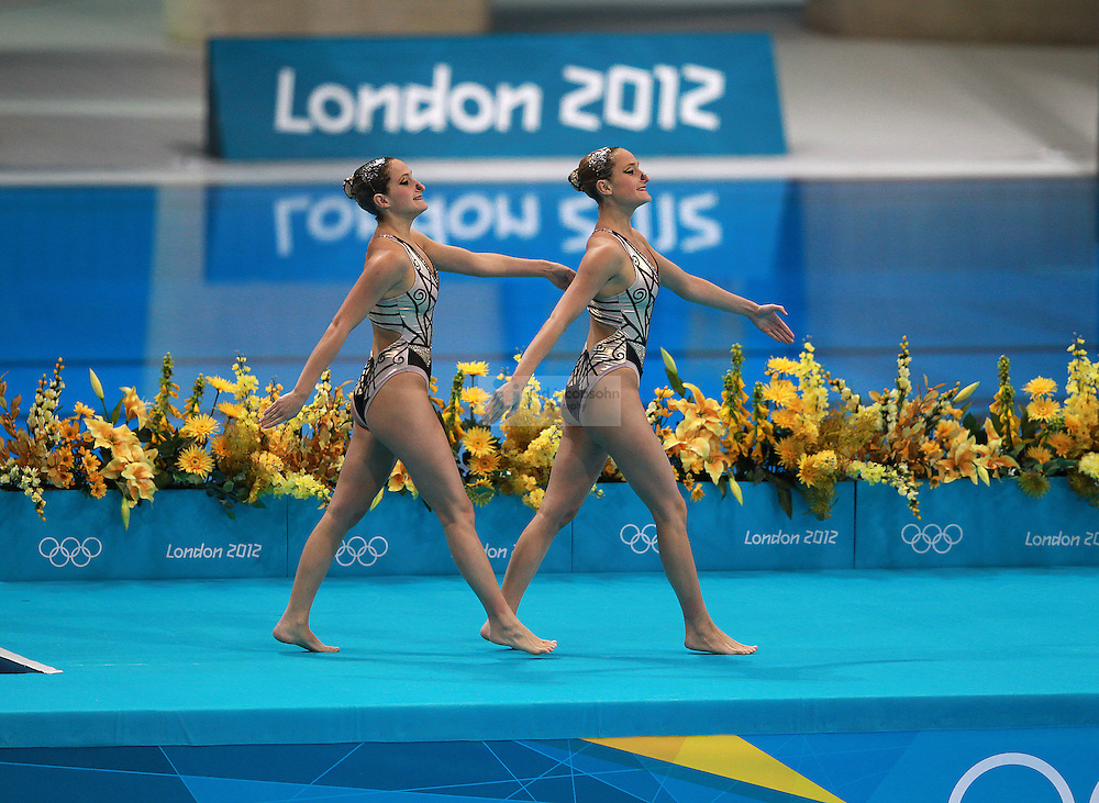 Etel Sanchez and Sofia Sanchez of Argentia compete during the women's duet synchronized swimming at the Olympic Stadium during day 10 of the London Olympic Games in London, England, United Kingdom on August 3, 2012..(Jed Jacobsohn/for The New York Times)..
