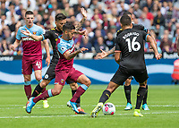 Football - 2019 / 2020 Premier League - West Ham United vs. Manchester City<br /> <br /> Manuel Lanzini (West Ham United) tries to break through the Manchester City midfield as West Ham search for the equaliser at the London Stadium<br /> <br /> COLORSPORT/DANIEL BEARHAM