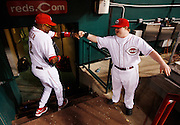 Friday, Aug. 17, 2012  REDS SPORTS : Cincinnati Reds manager Dusty Baker fist bumps with guest bat boy Ted Kremer of White Oak after their 7-3 win over the Chicago Cubs at Great American Ball Park.  The Enquirer/Jeff Swinger