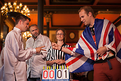 © licensed to London News Pictures. London, UK 08/08/2012. UK Rock Paper Scissors Championship takes place at The Knights Templar Pub in central London. Great Britain team competing against James May's Man Lab team. Over 100 contestants take part in unique decision making competition. Photo credit: Tolga Akmen/LNP