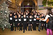 Choir, Save the Children's Festival of Trees Gala dinner. Natural History Museum. London. 4 December 2007. -DO NOT ARCHIVE-© Copyright Photograph by Dafydd Jones. 248 Clapham Rd. London SW9 0PZ. Tel 0207 820 0771. www.dafjones.com.