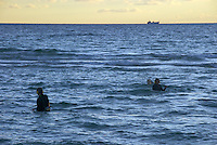 Treasure hunting in the ocean with metal detector equipment in Miami Beach.