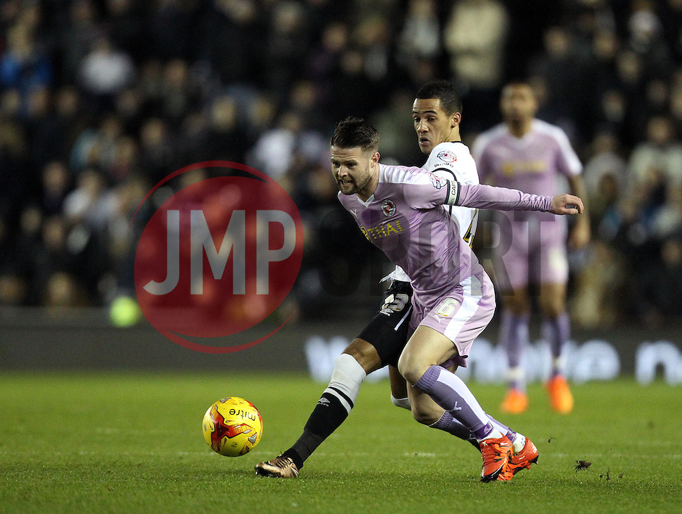 Oliver Norwood of Reading is tackled by Thomas Ince of Derby County - Mandatory byline: Robbie Stephenson/JMP - 12/01/2016 - FOOTBALL - iPro Stadium - Derby, England - Derby County v Reading - Sky Bet Championship