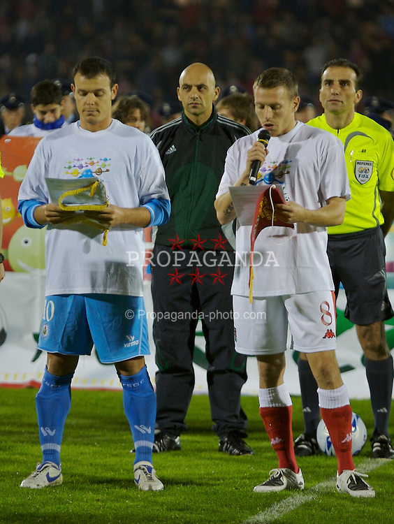 San Marino, San Marino - Wednesday, October 17, 2007: Wales' captain Craig Bellamy and San Marino's captain Andy Selva prepare to read out an anti-Racism statement before the Group D UEFA Euro 2008 Qualifying match at the Serravalle Stadium. (Photo by David Rawcliffe/Propaganda)