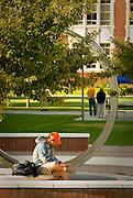 Idaho, Boise.  Young man studying outside on campus at Boise State University.