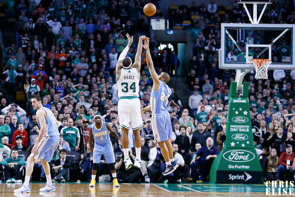 10 February 2013: Boston Celtics small forward Paul Pierce (34) takes a three point jumpshot over Denver Nuggets point guard Andre Miller (24) to tie the game in the second overtime during the Boston Celtics 118-114 3OT victory over the Denver Nuggets at the TD Garden, Boston, Massachusetts, USA.
