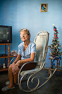 Environmental portrait of an old lady resting in a typical Cuban rocking chair