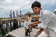 Staff are on hand to greet guests as the daily fastboat arrives at Song Saa island.