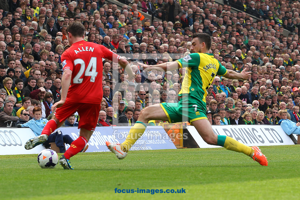 Robert Snodgrass of Norwich fouls Joe Allen of Liverpool and gets a yellow card from Referee Andre Marriner during the Barclays Premier League match at Carrow Road, Norwich<br /> Picture by Paul Chesterton/Focus Images Ltd +44 7904 640267<br /> 20/04/2014