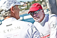 PORTUGAL, Cascais. 7th August 2011. America's Cup World Series. Day 2. L-R, Loick Peyron, Terry Hutchinson andRussell Coutts.