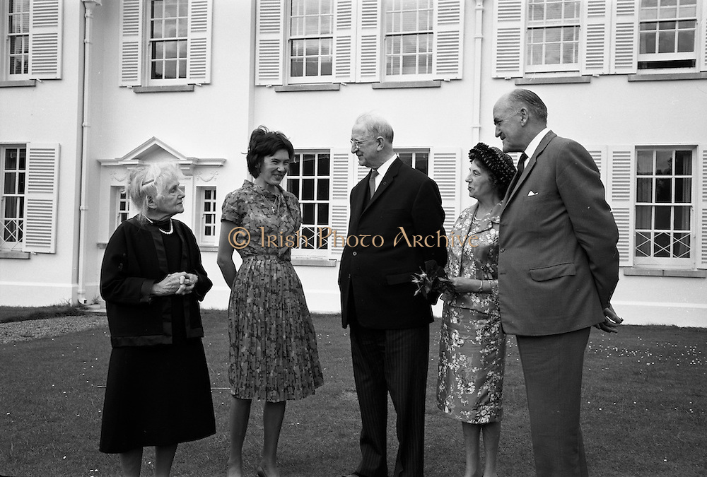 22/08/1963<br /> 08/22/1963<br /> 22 August 1963<br /> Mr Frank Aiken and family with President de Valera at &Aacute;ras an Uachtar&aacute;in. Image shows Sile de Valera; Aedamar Aiken, President Eamon de Valera; Maud Aiken and Frank Aiken.