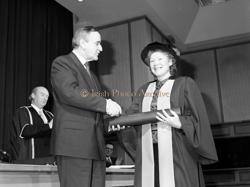 30/11/1992<br /> 11/30/1992<br /> 30 November 1992<br /> Conferring of Honorary Degrees (LL.D.) by the National Council for Educational Awards in Dublin Castle Conference Centre, Dublin. Picture shows Taoiseach Albert Reynolds, T.D. presenting Angela Collins O'Mahony, Ireland's first Woman Steeplejack with her degree. As a result of a contract she carried out at Shannon Airport for a Boston electronics firm, Mrs. Collins O'Mahony  joined with them in a joint venture company. the result was a factory in her home base of Kilkishen, Co. Clare, that developed a worldwide market for radomes - protective structures for radarr equipment and antenna systems. She also created much dura employment through the development of Leisure, sport and tourism businesses.