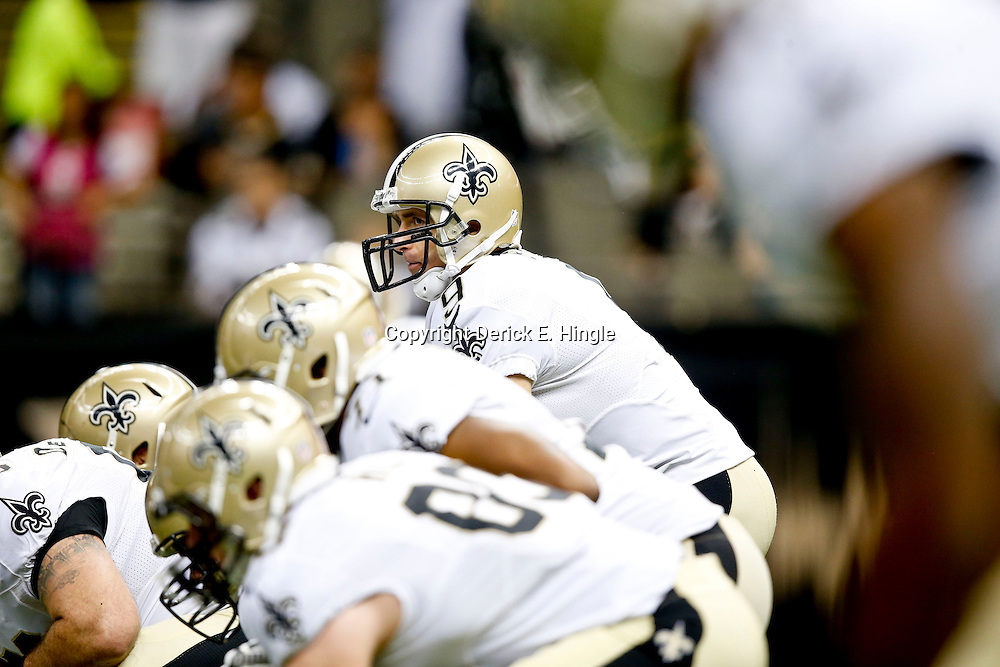 Sep 22, 2013; New Orleans, LA, USA; New Orleans Saints quarterback Drew Brees (9) under center against the Arizona Cardinals during a game at Mercedes-Benz Superdome. The Saints defeated the Cardinals 31-7. Mandatory Credit: Derick E. Hingle-USA TODAY Sports