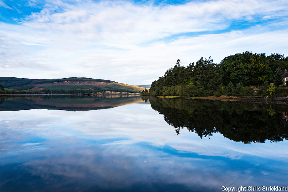 Catcleugh Reservoir, Byrness, Northumberland, England, UK. 1st October 2016. A still autumn morning reflects on the surface of Catcleugh Reservoir in Northumberland.
