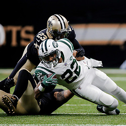 Dec 17, 2017; New Orleans, LA, USA; New York Jets running back Matt Forte (22) is tackled by New Orleans Saints cornerback Marshon Lattimore (23) during the second half at the Mercedes-Benz Superdome. The Saints defeated the Jets 31-19. Mandatory Credit: Derick E. Hingle-USA TODAY Sports