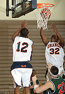 Middletown, NY - Malik Jenkins (32) of SUNY Orange takes a shot against Rockland Community College in a Mid-Hudson Conference men's basketball game in Middletown on Feb. 26, 2008.