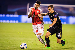 Alex Oxlade-Chamberlain #15 of Arsenal F.C. vs Josip Pivaric #19 of GNK Dinamo Zagreb during football match between GNK Dinamo Zagreb, CRO and Arsenal FC, ENG in Group F of Group Stage of UEFA Champions League 2015/16, on September 16, 2015 in Stadium Maksimir, Zagreb, Croatia. Photo by Ziga Zupan / Sportida