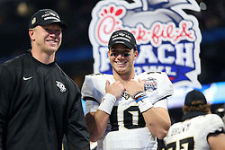 UCF Knights quarterback McKenzie Milton (10) celebrates beating the Auburn Tigers during the 2018 Chick-fil-A Peach Bowl NCAA football game on Monday, January 1, 2018 in Atlanta. The UCF Knights beat the Auburn Tigers 34-27. (Jason Parkhurst / Abell Images for the Chick-fil-A Peach Bowl)
