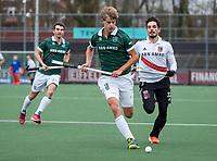AMSTELVEEN -  Justen Blok (Rdam)  met Tanguy Cosyns (Adam) tijdens  de hoofdklasse hockeywedstrijd Amsterdam-HC Rotterdam (7-1).    COPYRIGHT KOEN SUYK
