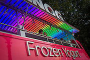 Young couple enjoy frozen yoghurt at a mobile kiosk on London's Southbank.