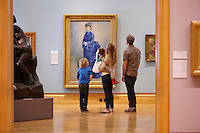 Family looking at Renoir's La Parisienne (also known as 'The Blue Lady')<br /> Impressionist Gallery<br /> National Museum<br /> Cardiff<br /> South<br /> People<br /> Lifestyle<br /> Arts<br /> Galleries<br /> Tourist Attractions