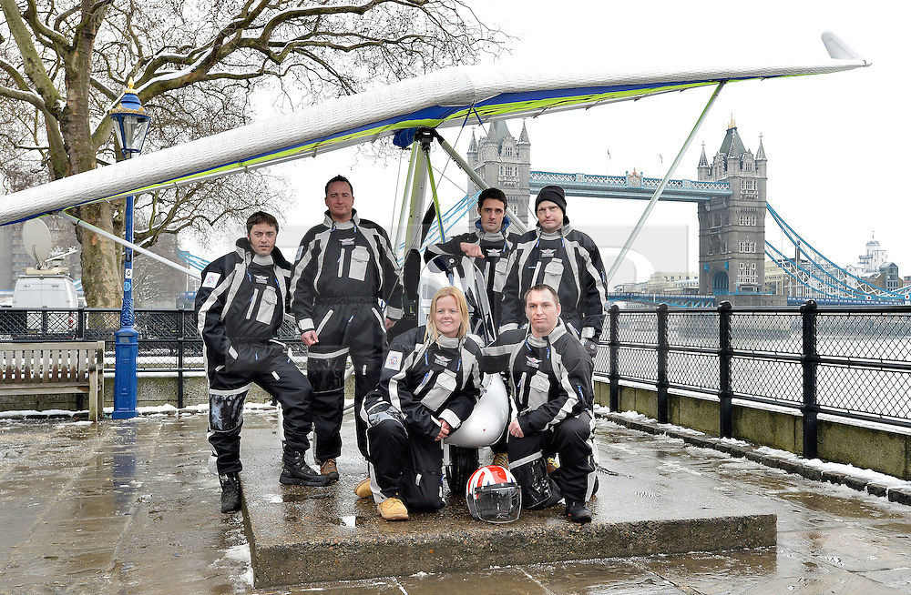 © Licensed to London News Pictures. 22/01/2013. London, United Kingdom. Injured servicemen bid for world-first antarctic mission.  A team of injured servicemen are to attempt a world first microflight to the south pole. Pictured R to L Capt Martin Hewitt, Capt Luke Sinnott, Flt Lt Kat Janes, Pte Nathan Foster, Former Lcpl Jamie Hull, Cpl Alan Robinson. Photo credit : Justin Setterfield/LNP.