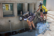 Cyclists drink thermal spring water at Fonte de Sao Joao, on 17th July 2016, in the spa resort of Luso, Portugal. In the 11th century, Luso was a sleepy village linked to a monastery in the hills near Coimbra but it became a lively spa resort in the 1700s as its hot water springs became a focus for tourism. The waters here are said to have therapeutic value in the treatment for bad circulation, muscle tone, rheumatism and renal problems. (Photo by Richard Baker / In Pictures via Getty Images)