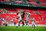 Christopher Swailes  of Morpeth Town AFC heads over under pressure from Mike Symons of Hereford FC and Jamie Willets of Hereford FC during the FA Vase match between Hereford FC and Morpeth Town at Wembley Stadium, London, England on 22 May 2016. Photo by Mike Sheridan.