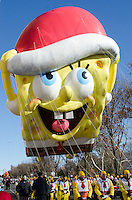 NEW YORK, NY, USA, Nov. 28, 2013. The Songebob Squarepants balloon moves down Central Park West during the 87th Annual Macy's Thanksgiving Day Parade.