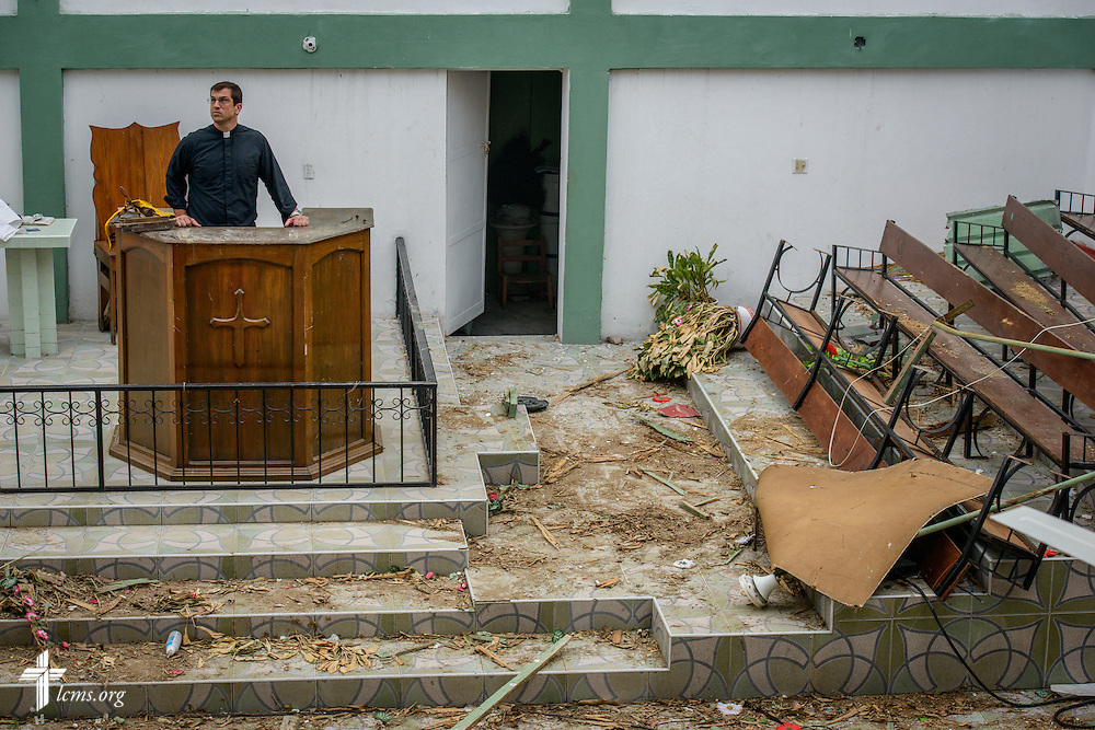 The Rev. Ross Johnson, director of LCMS Disaster Response, surveys damage to First Lutheran Church of Les Cayes on Tuesday, Oct. 11, 2016, in Haiti.  Hurricane Matthew destroyed the roof and the inside sanctuary.  LCMS Communications/Erik M. Lunsford
