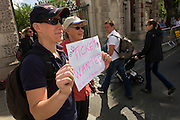 London 2012 Olympic spectators from Australia hold home-made signs asking for unwanted equestrian tickets as visitors arrive along the old streets of Greenwich, London. On the day that 3,000 extra tickets were put on sale after criticism of empty seats at some events, sports fans were desperate to see the eventing and dressage on day 4 of the London games.