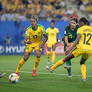 GRENOBLE, FRANCE June 18.  Sam Kerr #20 of Australia scores her third goal as she shoots past Sashana Campbell #12 of Jamaica, Allyson Swaby #17 of Jamaica an goalkeeper Nicole McClure #13 of Jamaica during the Jamaica V Australia, Group C match at the FIFA Women's World Cup at Stade des Alpes on June 18th 2019 in Grenoble, France. (Photo by Tim Clayton/Corbis via Getty Images)