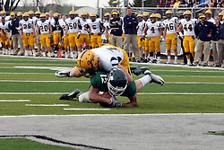 12 November 2011:  Cole Urban stops Joey Driver just short of a touchdown during an NCAA division 3 football game between the Augustana Vikings and the Illinois Wesleyan Titans in Tucci Stadium on Wilder Field, Bloomington IL