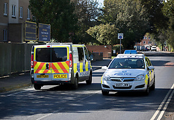 © Licensed to London News Pictures. 30/09/2016. Oxford, UK. Police vehicles drive on the Marston Ferry Road in the Summertown area of Oxford. A police hunt continues in Oxford for two men who abducted and raped a 14-year-old girl while she was on her way to school. The teenager was snatched and driven away from the Summertown area of Oxford at 8.25 on Wednesday morning. Photo credit: Peter Macdiarmid/LNP
