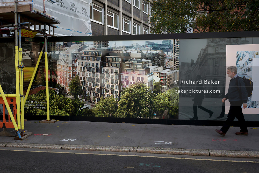 "A pedestrian walks past a construction hoarding for the new luxury apartment development called The Denizen, a controversial 10-storey building by Taylor Wimpey that locals say will dominate their view and block their daylight, on 30th October 2017, in London, England. Residents from Bowater House on the Golden Lane Estate have erected banners by artists Jeremy Deller and Elizabeth Price to picket the developers. Despite this, Wimpey say, ""We are one of the UK's largest residential developers. As a responsible developer we are committed to working with local people and communities."""