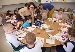 Emmanuelle Benefield, director/teacher, left, and  Brian Benefield, teacher interact with students at Ma Petite École, in Santa Rosa, California.