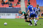 Jamie Allen, Will Grigg during the Sky Bet League 1 match between Wigan Athletic and Rochdale at the DW Stadium, Wigan, England on 28 March 2016. Photo by Daniel Youngs.