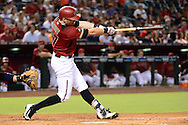 PHOENIX, AZ - JULY 06:  Brandon Drury #27 of the Arizona Diamondbacks hits a two run home run during the third inning against the San Diego Padres at Chase Field on July 6, 2016 in Phoenix, Arizona.  (Photo by Jennifer Stewart/Getty Images)