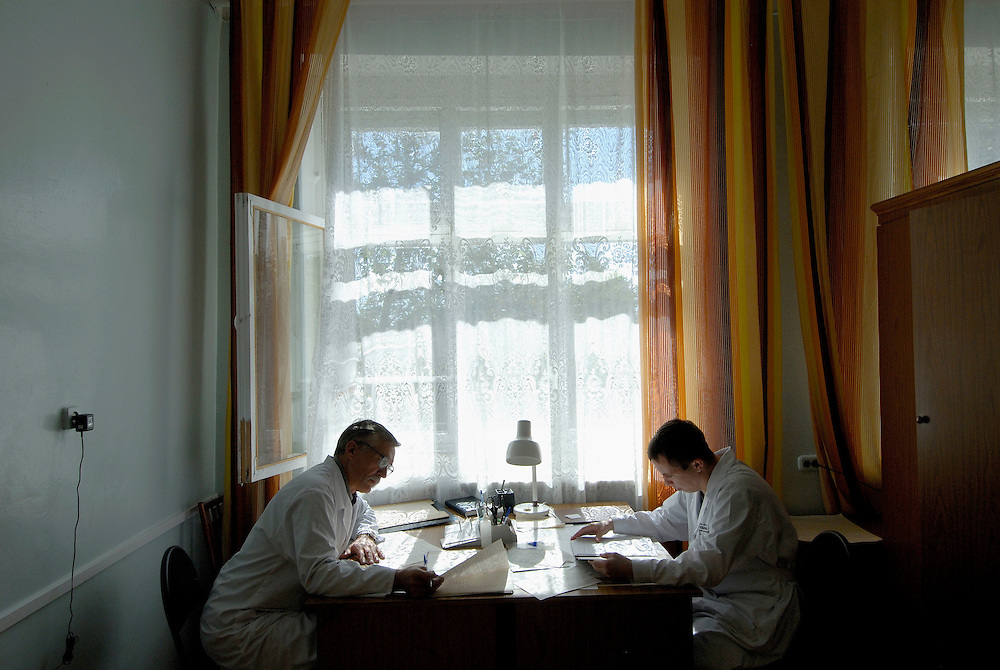 Russia. Tomsk (Siberia). 23.08.2007. TB Hospital. Doctors at work in their offices. Dr. Anatoly Yanov (left) and Dr. Oleg Anastasov.