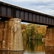 """""""Supported Reflections""""<br /> <br /> A wonderful train bridge and supports on the Huron River in Ann Arbor Michigan!!<br /> <br /> Architecture: Structures and buildings by Rachel Cohen"""
