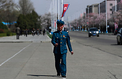 A North Korean soldier walk along the road beside the Tower of the Juche Ider in Pyongyang, North Korea, 12 April 2017. North Koreans prepare to celebrate the 'Day of the Sun Festival', 105th birthday anniversary of former North Korean supreme leader Kim Il-sung in Pyongyang on 15 April.