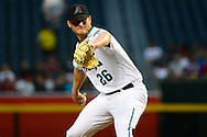 Apr 5, 2016; Phoenix, AZ, USA; Arizona Diamondbacks starting pitcher Shelby Miller (26) delivers a pitch in the first inning against the Colorado Rockies at Chase Field. The Arizona Diamondbacks won 11-6.  Mandatory Credit: Jennifer Stewart-USA TODAY Sports