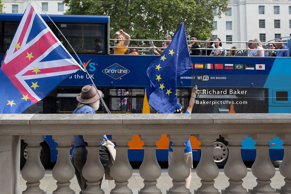 On the day that British Prime Minister Boris Johnson sought to have Parliament suspended by Queen Elizabeth, days after MPs return to work in September - and only a few weeks before the Brexit deadline, a tour bus drives past pro-EU Remain voters protest outside the Cabinet Office where daily Brexit contingency planning meetings take place, on 28th August 2019, in Whitehall, Westminster, London, England.