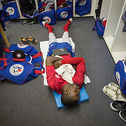 The Vancouver Canadians starting pitcher, Miguel Castro, relaxes before the game, in Boise, Idaho.  After the game, Castro found out he was being promoted to the Lansing Lugnuts, the Toronto Blue Jays Mid West League minor league team.