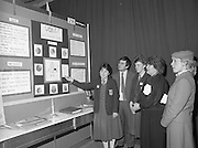 11/01/1985.01/11/1985.11th January 1985.The Aer Lingus Young Scientist Exhibition at the RDS Dublin ..Elaine O'Reilly (left) and Clodagh O'Herlihy (third from left) both of the Loretto Abbey, Dalkey, Co. Dublin showing their Exhibit 'Work, The Housewife's Flexible Friend' to Gemma Hussey, T.D. (4th from left) Minister for Education and George Birmingham, T.D. Minister of State at the Department of Labour during their visit to the stands. Also pictured is Aer Lingus Hostess Sally Ann Flanagan.